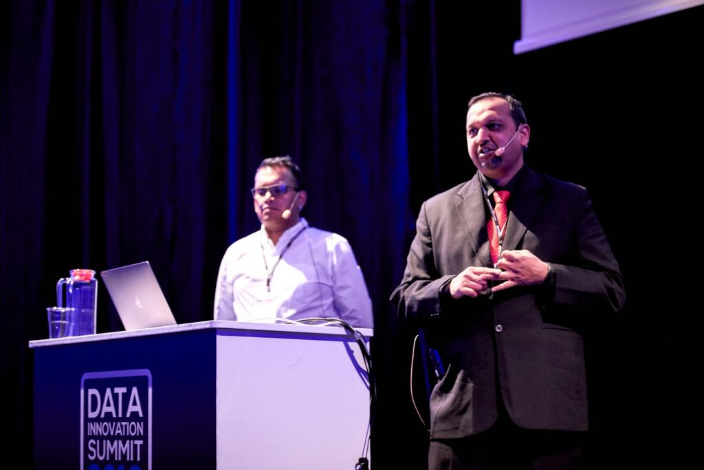 Ritesh Agrawal and Anando Sen presenting at the Data Innovation Summit 2019